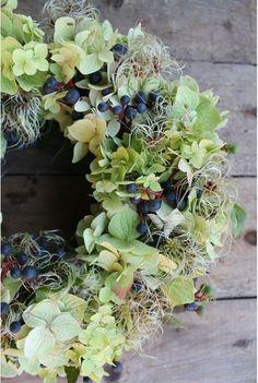 beautiful wreath with hydrangea and dark berries