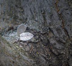 Asymmetric leaf earstuds in fine and sterling silver / door deBATjes