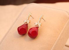 http://www.aliexpress.com/store/product/Branded-Korea-Red-Agate-Gold-Plated-Drill-Original-Women-s-Fashion-Stud-Earring-in-Jewelry-Accessories/239061_1970424590.htm Find More Stud Earrings Information about Branded  Korea Red Agate Gold Plated Drill Original Women's Fashion Stud Earring in Jewelry Accessories 2014,High Quality Stud Earrings from Hawaii Arts Jewelry