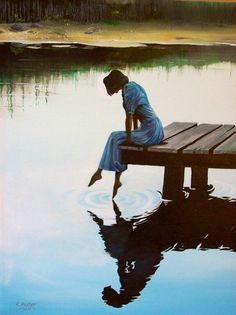 Girl sitting on edge of pier with toe touching water art