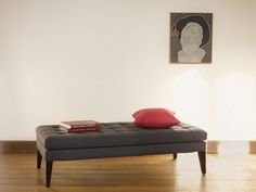 This sofa.com Club ottoman in Granite Soft Wool can easily double as a coffee table for all your favorite things. - $660