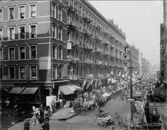 """The Ghetto, New York, N.Y. photographed by the Detroit Publishing Company in 1909 on 11x14 glass plate negative. """"Rivington Street"""" on sign., Lower East Side, New York."""