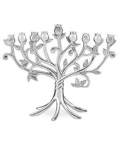 Shed new light on a favorite Hanukkah tradition with this Lenox Blessings menorah. Silvertone metal twists and blooms into nine pomegranates, a symbol of fruitfulness, knowledge and wisdom. | Aluminum