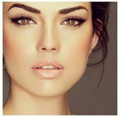 Sleek and classic brunette make up inspiration cats eyes with thick wings nude lips soft cheeks and strong brows