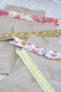 Use fabric scraps and turn a brown lunch bag into a cute and simple gift bag