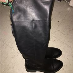 Black boots Great condition worn couple of times the zipper  don't  go all the  way  down  its  there for fashion Shoes