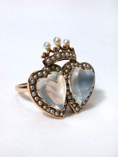 Antique Double Moonstone Heart Ring. During the late 19th century moonstone was adopted as an alternative to precious gems and was imbued with a mystery and aura that it aroused tender passions.