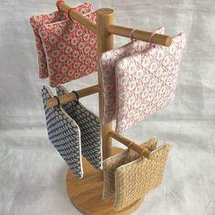 刺し子のコースター出来ました☺︎刺し子糸で三つ編みした、引っ掛け紐付きです今日は曇り空で暗めの写真☁️#刺し子#sashiko #コースター#キッチン雑貨#stitching #handstitched
