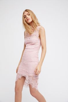 Peekaboo Lace Slip | Bodycon lace slip with scalloped boat neck, frayed cap sleeve, and asymmetrical hem with sides longer than center. Lining has sweetheart neckline.