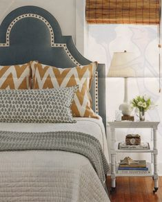 Love the color combo (slate and ochre) and you could totally DIY a similar headboard with grosgrain ribbon & nailhead trim.