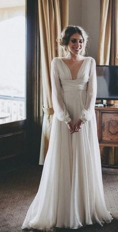 Chic vintage inspired cuffed long-sleeve empire waist wedding dress; Featured Dress: Paolo Sebastian