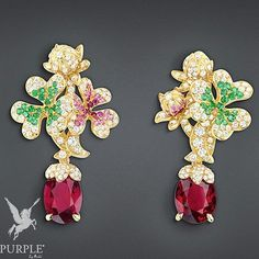 """Be the center of attraction take a look at this """"Trèfle"""" earrings in 18K yellow gold diamonds rubies emeralds and pink sapphires by @dior #purplebyanki #diamonds #luxury #loveit #jewelry #jewelrygram #jewelrydesigner #love #jewelrydesign #finejewelry #luxurylifestyle #instagood #follow #instadaily #lovely #me #beautiful #loveofmylife #dubai #dubaifashion #dubailife #mydubai #Earrings #18KYellowGold #Rubies #Emeralds #PinkSapphires"""