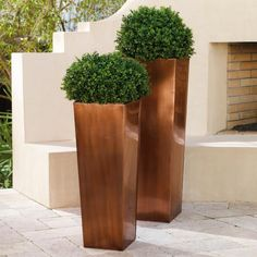 There's something absolutely indescribable about the way copper interplays with the environment. We just think it's magic.  Grandin Road Editors   A Grandin Road exclusive, this Steel Column Planter is fit to beautify any front porch or garden.Planters are skillfully crafted from rust-resistant stainless steelAntiqued copper finish adds time-worn characterIncluded custom inserts reduce the amount of planting material requiredPlanter has drainage hole