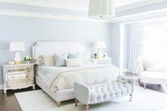 Pastel blue walls in white bedroom