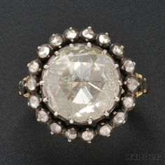Antique #Rose-cut Diamond Ring, set with a #rose-cut diamond framed by #rose-cut diamonds, silver-topped gold mount. Probably Georgian