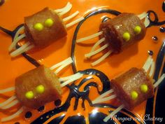 Spooky Spiders - sliced hot dogs with spaghetti pushed thru & then boiled. EEK!
