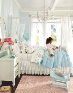 Pale blue and white create the sparkle of a sunny day in this bedroom, with decorative painting on the walls to give the entire room a dreamy, faraway quality. Pops of bright pink add texture and interest. We opted for a canopy bed and an ornate, glittering chandelier to bring in a distinctly fairy tale-like flourish. This would be so cute for Cortney.