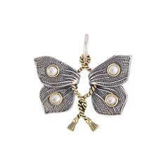 This pendant honors a butterfly at the moment of its bravery and transformation.