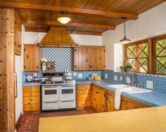 Furniture Fabulous Traditional Kitchen With Inspiring Knotty Pine Kitchen Cabinets Also Dark Red Tiling Floor