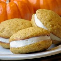 Pumpkin Whoopie Pies | A fall favorite. A cake-like pumpkin cookie filled with a creamy frosting. You can also use a cream cheese filling if you prefer. Either way- delicious!