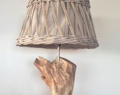Table lamp manufacture of weathered old oak branch with grey Wicker Lampshade.