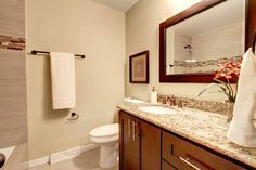 master bath remodel in Glendale AZ all wood vanity, granite countertops, dual under-mount sinks and porcelain tile floor and shower  www.kitchenazcabinets.com