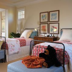 Twin Bedrooms Design Ideas, Pictures, Remodel, and Decor - page 15 love the use of mixed prints, storage at end of beds