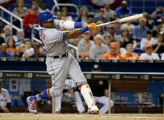 New York Mets' Yoenis Cespedes hits a home run during the third inning of the team's baseball game against the Miami Marlins, Thursday, April 13, 2017, in Miami.