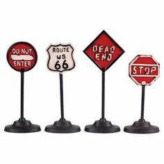 """Showcasing road sign motifs, this charming metal decor set brings a vintage-inspired touch to your console table or mantel.    Product: 4-Piece decor setConstruction Material: IronColor: MultiDimensions: 10-13"""" H"""