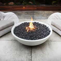who wouldn't want to sit out and watch their great bowl of fire for a while?  I like that this is simple/modern and not like every other firepit/chiminea.