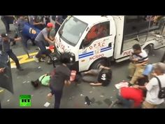 WATCH:Philippines anti-US protesters rammed by police van