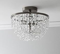 The Reilly Crystal Flush Mount is minimal in design, but maximal in details. The pewter-finished frame is simple, which is contrasted by drops of elegant crystals. Flush Mount Chandelier, Antler Chandelier, Outdoor Chandelier, Flush Mount Lighting, Chandeliers, Faceted Glass, Faceted Crystal, Curtain Hardware, Chandelier