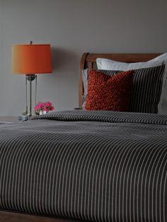 Amazing Condo Interior Decorating Ideas : Charming Modern Bedroom With Striped Bedspread Wooden Headboard Condo