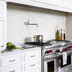 Classic Subway Tile  Rectangular white subway tile installed in a traditional brick pattern gives any kitchen a welcoming, vintage charm. In this cooking zone, the classic tile choice is a perfect fit for the room's traditional cabinetry and marble-look countertops. Subway tile is available in ceramic, glass, and stone and in a range of colors to fit both traditional and contemporary spaces.