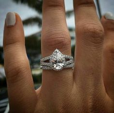 Pear shaped diamond halo ring **Clint likes** maybe not as studded- more sleek on the band, would like to discuss marquise cut stones for wedding band Pear Wedding Ring, Cool Wedding Rings, Diamond Wedding Rings, Halo Diamond, Wedding Jewelry, Wedding Bands, Teardrop Diamond Ring, Diamond Rings, Engagement Solitaire