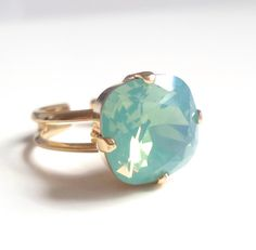 Mint opal square stone crystal ring This elegant crystal cocktail ring makes quite a statement. I have hand set a large 12mm square cushion cut