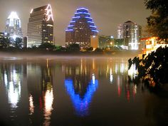 Austin night skyline reflected on Lady Bird Lake.