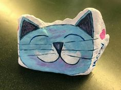 Painted cat rock
