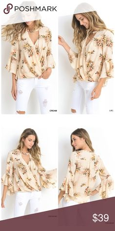Stunning cream surplice floral top -Floral surplice top with three quarter bell sleeves and clasp choker. Unlined. Non-sheer. Tops