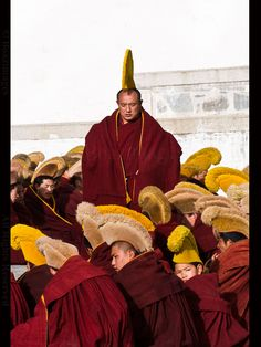 LABRANG | Geluk ( Yellow hats school )  Tibetan monks with a high ranking Lama at Labrang monastery in Xiahe.