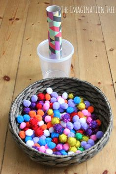 Pom pom drop and shoot game for toddlers