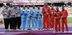 Bahamas' men's relay team is flanked by Trinidad's bronze medalists and USA's silver medallists. Nbc Olympics, 2012 Summer Olympics, Ancient Olympics, Javelin Throw, Team Usa, Track And Field, Olympians, Trinidad, Bronze