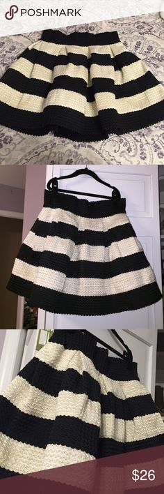 Black & Ivory Highwaisted Skirt Very cute. Only worn 1 time for an engagement party. Size Large. Bought at a boutique in the mall. Can be worn with a black crop top shirt or body suit. Skirt is thick and textures and comes high to the waist. And flares out. Loved this skirt L'atiste Skirts A-Line or Full