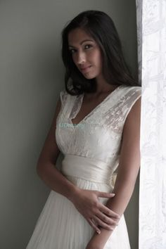 Vintage wedding dress with A-line silhouette and floor length. Embroidered lace are embellished on the v-neck bodice. Wide satin waistband slims the waist to creat sweet bohemian look. Free made-to-measurement service for any size. Available colors seen as in Color Options.