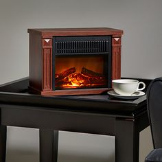 "Supplemental heat and comfortable ambiance This Hearth Heater is just 10"" tall, but powerful enough to gently warm a 250 sq. ft. room. Like an electric fireplace, Real Glow™ technology provides realistic dancing flames with a bed of flickering embers that can be used with or without the built-in heater. Small enough to fit on any desk, bookshelf, entertainment center, or night stand, the built-in blower circulates 4,100 BTU's throughout the area being heated."