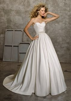 Wedding Dresses by Morilee. Luxurious A-Line Bridal Dress with sparkling Waistband. The Chapel Length is perfect for your spectacular Walk down the Aisle.