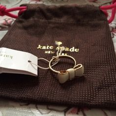 HP Kate Spade Bow Ring Size 7 Brand new with tags white bow ring. Super cute and in size 7. Comes with KS Storage pouch♠️ Price Firm & No trades  Host Pick- Style Obsessions  2/3/2016 kate spade Jewelry Rings