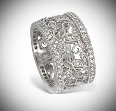 Gregg Ruth 18 karat white gold wide flower design band set with 1.04 carats of round brilliant diamonds total! This unique ring has a beautiful milgrain finish.