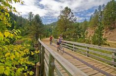 George S. Mickelson Trail, a 109-mile rail trail in South Dakota's Black Hills that passes close to Mt. Rushmore and the Crazy Horse Memorial. Not paved; end points are Deadwood and Edgemont.