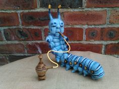 Check out this item in my Etsy shop https://www.etsy.com/listing/226271861/ooak-needle-felted-alice-in-wonderland